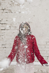 Winter snowy portrait of a young woman wearing red jacket