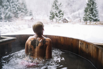 Woman swimming in outside tub
