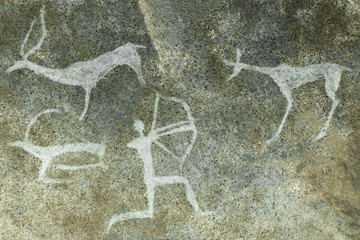An image of a hunt on a cave wall made by an ancient man. ancient world history. archeology