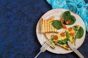 Frittata with asparagus, cherry tomatoes and spinach