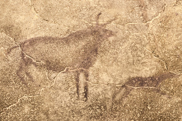 An image of ancient animals on the wall of the cave. history. archeology. era.