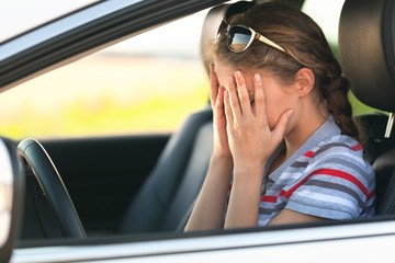 Portrait of Young Woman Crying in her Car
