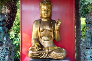 Buddha statue shows the hand gesture of vitarka mudra that transmits Buddha's teachings.