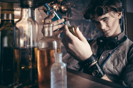 Portrait of a mad scientist chemist in his laboratory in the steampunk style.