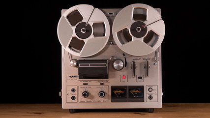 Vintage Reel to Reel tape recorder playing music