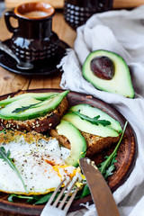 Breakfast skillet pan of fried egg and avocado