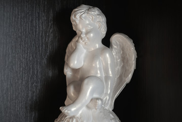 a statuette of an angel in white