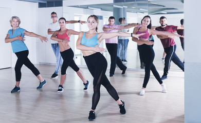 adults of different ages dancing at dance class