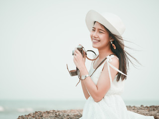 Asian woman with vintage camera