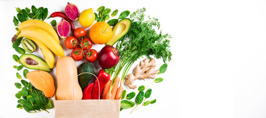 Healthy food background. Healthy vegetarian food in paper bag fruits and vegetables on white background. Shopping food supermarket concept. Long format with copy space