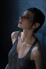 Sexy brunette in wet t-shirt high angle view