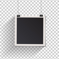 Blank retro vintage photo frame set hanging on a clip.