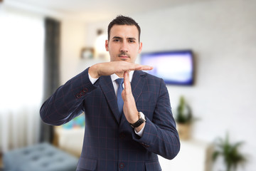 Real estate agent realtor making time for break pause gesture.