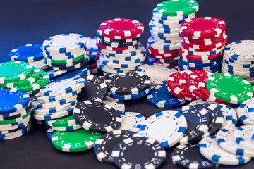 Poker chips isolated on black background