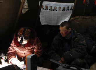 Local residents take part in the early voting ahead of the presidential election at a reindeer camping ground in Nenets Autonomous District