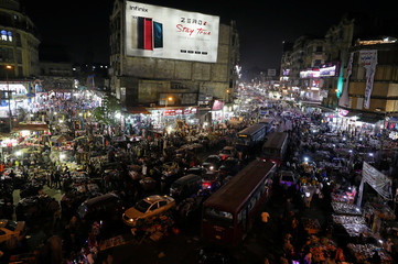 People shop at Al Ataba, a popular market in central Cairo