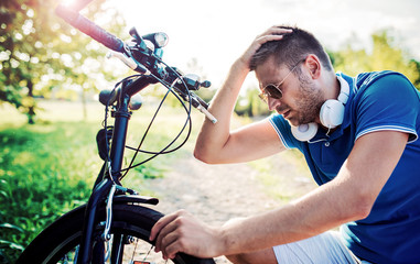 Cyclist has a problem with a tire during the bike ride. Sport and recreation concept