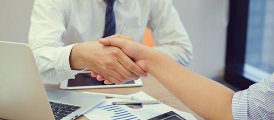 close up business man handshake with parrtner concept