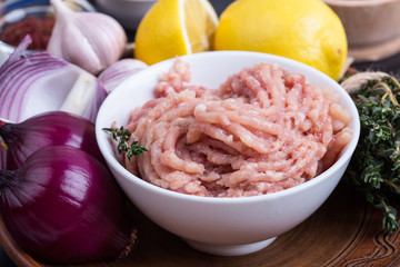 Minced chicken meat.  Fresh ingredients for healthy meal preparation
