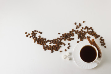 White cup with coffee, coffee beans on a white background. Flat lay, top view