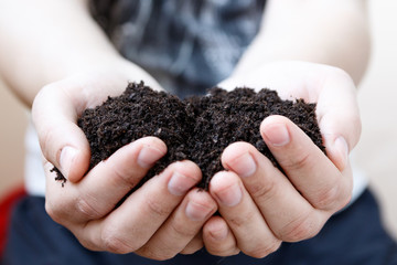 Man farmer holding soil. Earth day and ecology concept