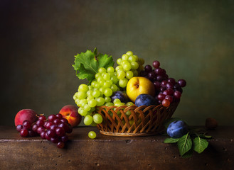 Still life with pears, grapes and plums