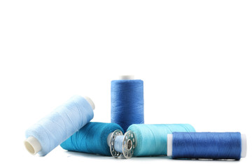 Blue thread spools isolated on a white