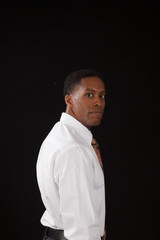 Pensive Black man with eye contact