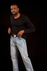 Thoughtful black man in black shirt