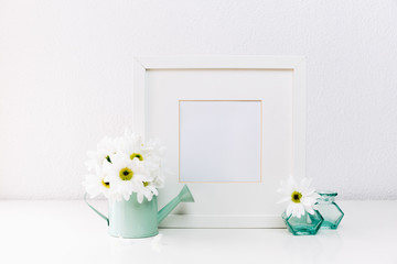 Photo frame with spring flower. Minimal Mock up. Front view, copy space