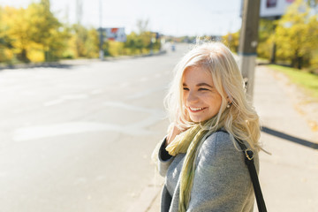 girl is walking in the park, a fashionable girl on an autumn walk