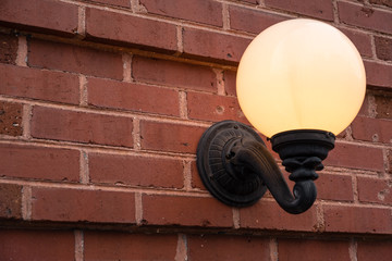 globe light on brick wall illuminated warm glow