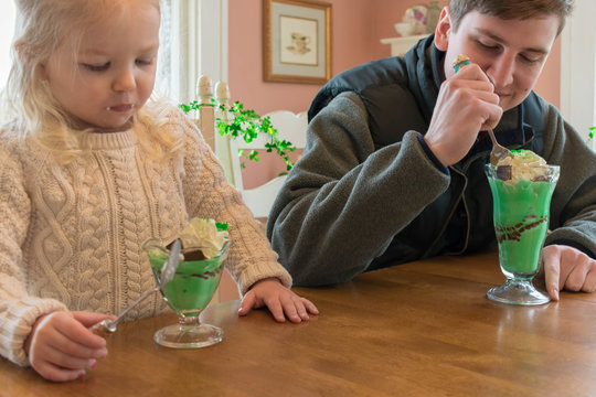 Eating ice cream sundaes decorated for St. Patrick's Day