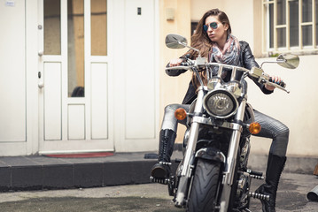 Rock and roll lifestyle, young alternative woman on a motor bike