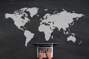 Global Business Concept With Laptop On Blackboard