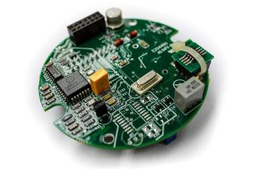 Closeup of electronic circuit board with CPU microchip electronic processor components  on withe background