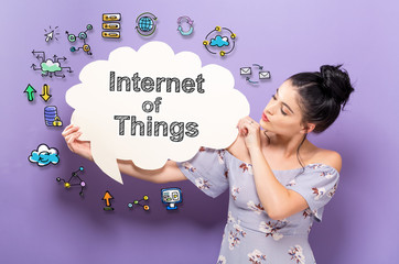 Internet of Things with young woman holding a speech bubble