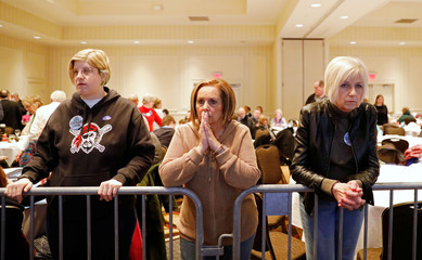 Supporters of U.S. Democratic congressional candidate Conor Lamb react to the results coming in during Lamb's election night rally in Canonsburg