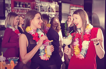 Two women on Hawaiian party at nightclub