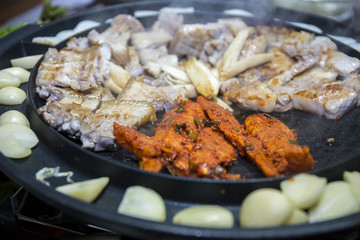 Cooking Korean style barbeque pork with deodeok