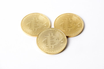 Golden Bitcoins on a white background