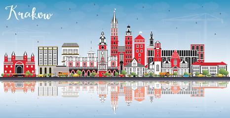 Krakow Poland City Skyline with Color Buildings, Blue Sky and Reflections.