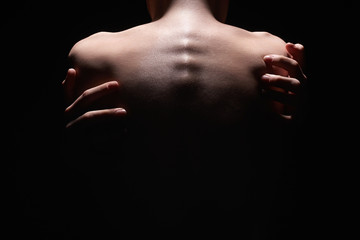 Naked Woman Back in Dark. Female Hands