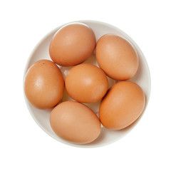 Brown eggs on white plate
