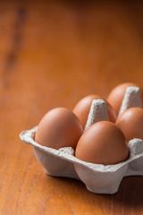 Eggs in cardboard on table