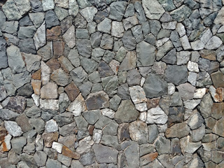 Old Mosaic stone wall texture and background