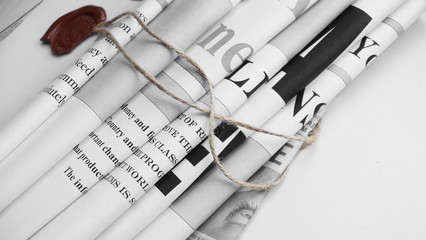 News - fresh newspapers with headlines and articles. Folded papers tied up with rope and red wax seal or stamp. Concept for business and communication