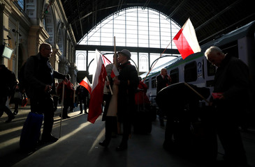 Polish right-wing activists arrive at Keleti station to join the pro-Orban march to be held on the anniversary of the 1848 Hungarian Revolution in Budapest