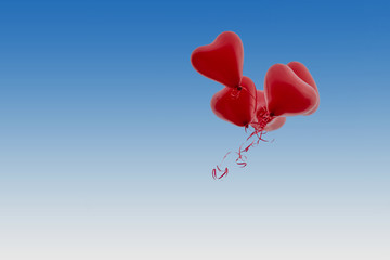 red Balloons fly on weddings in the blue sky  horizontal