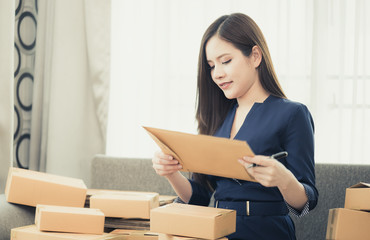 Small business woman is preparing to send out her product in boxes